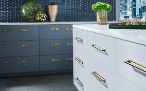 what color hardware for navy cabinets why the honey bronze color trend has become an interior