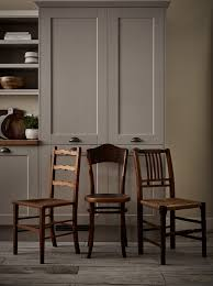 mix and match reclaimed chairs in similar tones to complete the