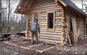 log house timelapse of a man building a log cabin from scratch with no power