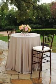 wedding linens cheap ivory highboy table linens covered in gold organza overlays with