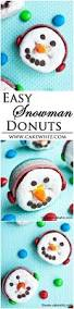easy snowman donuts wearing ear muffs fun winter craft to do