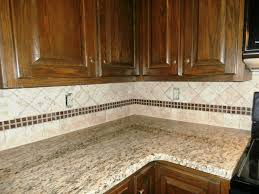 cream glazed kitchen cabinets red backsplash gray kitchen cabinets with white countertops