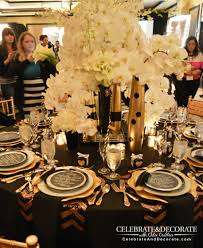 modern black and gold tablescape black table floral