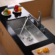 decorating traditional kitchen design with black graff faucets