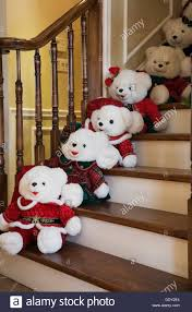 staircase in a residential home decorated with santa claus teddy