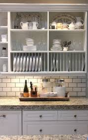Plate Holders For Cabinets by Plate Holders And Open Cabinets For Above The Sink This Is