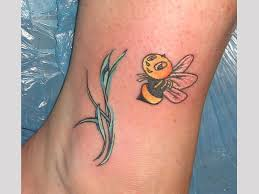 cute bee tattoo design for leg