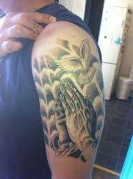hand and dove tattoo