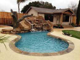 decor small inground pool with chic waterfall and rocks for