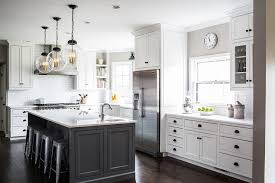 white kitchens with islands white cabinets with charcoal gray kitchen island transitional