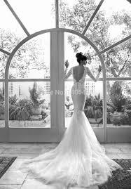 turmec lace long sleeve low back wedding dress
