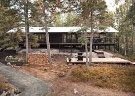 single story house story summer house overlooks forested gorge in sweden