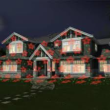 Outdoor Laser Projector Christmas Lights by The Virtual Christmas Display Laser Light Projector Hammacher