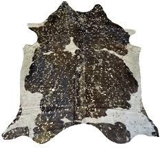 Laminate Floor Rugs Decorating Cowhide Skin And White Cowhide Rug At Living Room
