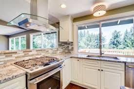 bianco antico granite with white cabinets white raised panel cabinets with bianco antico granite pius