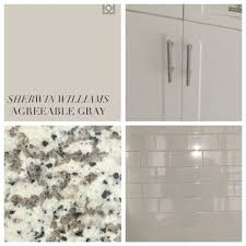 what color kitchen cabinets go with agreeable gray walls kitchen white cabinets white nevada granite white subway