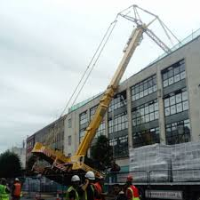 people rehoused after crane topples in reading town centre bbc news
