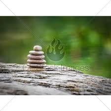 stack of zen rocks in garden gl stock images