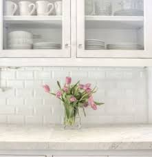 white shaker kitchen cabinets with white subway tile backsplash the white shaker style kitchen will never be out