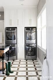 Pull Out Laundry Cabinet Pull Out Cabinets Between Stacked Washers And Dryers