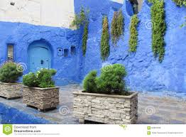 The Blue City Morocco by Blue Door In A Blue Wall In Chefchaouen Morocco Stock Photo