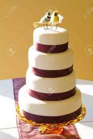 a traditional white wedding cake is topped with craft birds and