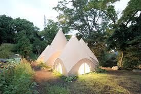 issei suma completes a series of wooden tent structures for