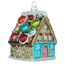 gingerbread house with a macaron roof glass ornament tinsel and