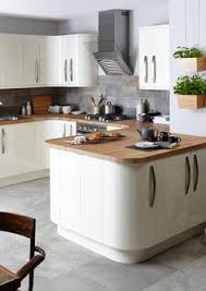 Tiled Kitchen Worktops - our edge grigio tiles look lovely in a cream kitchen with wooden