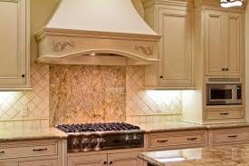 kitchen cabinet backsplash white cabinets brown countertop