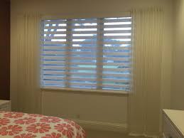 sheer duo shades with ripple fold curtains gives a great elegant