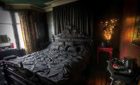 dark bedroom paint colors above headboard witch accent pillow