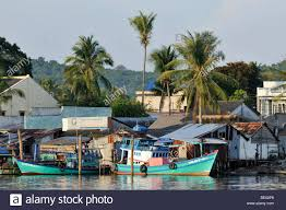 fishing boats and quaint fishing village with simple colorful