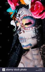 halloween costume mexican skeleton close up of catrina skull face isolated on white background stock