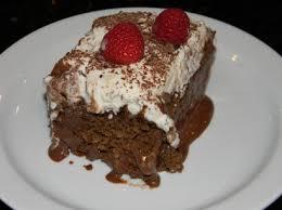 chocolate tres leches cake with fresh whipped cream u0026 raspberries