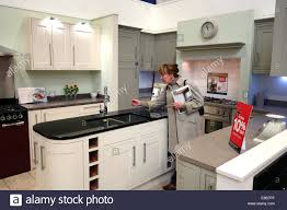 woman shopping looking at new kitchen kitchens at wickes uk stock