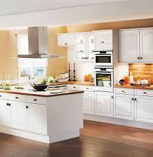 white kitchen cabinets orange walls white modern kitchen in the interior home interior design