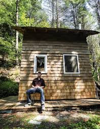 college student living rent free in his 96sf offgrid tiny house