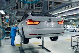 bmw ads bmw to extend production halts in germany to china and south