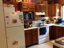 Kitchen Cabinet Update An Update On Painted Kitchen Cabinets And Counter Tops Hometalk