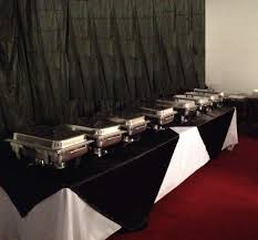 black and white buffet table with black backdrop venue designs