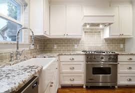 bianco antico granite with white cabinets ann sacks tile convention dallas traditional kitchen decorators with