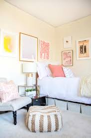 pink and blush dorm room design with tufted slipper chair and