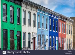 Row Homes by Colorful Row Houses On Howard Street In Old Goucher Baltimore