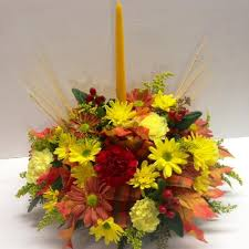 traditional single candle thanksgiving centerpiece lipinoga florist