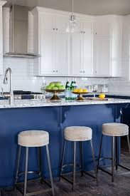 white upper cabinets blue lower cabinets transitional kitchen