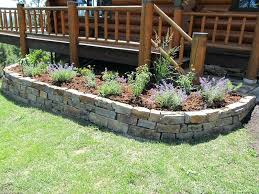 stone landscape ideas photo of a large traditional backyard stone