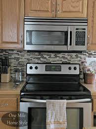 cost of kitchen cabinets cost of tile backsplash davis cabinets caring for corian