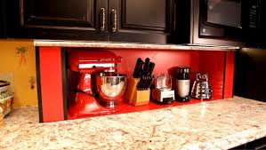 kitchen appliance storage cabinet disappearing cabinets ensuring easy access to hidden kitchen spaces