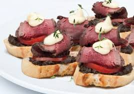 beef canape recipes beef fillet with tomatoes on tapenade encrusted crostini recipe